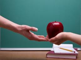 Student Giving Apple to the Teacher